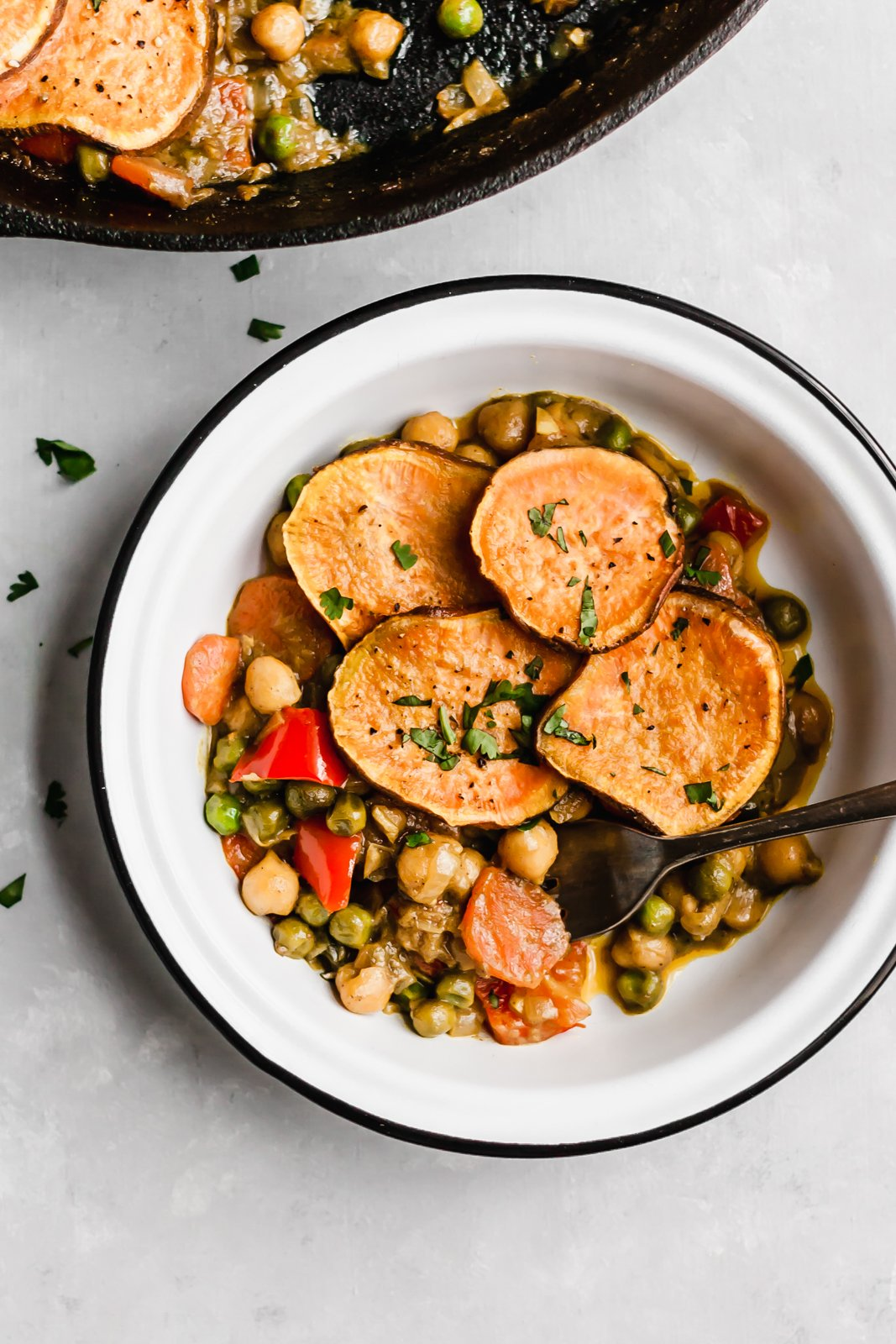 chickpea pot pie in a bowl with a fork