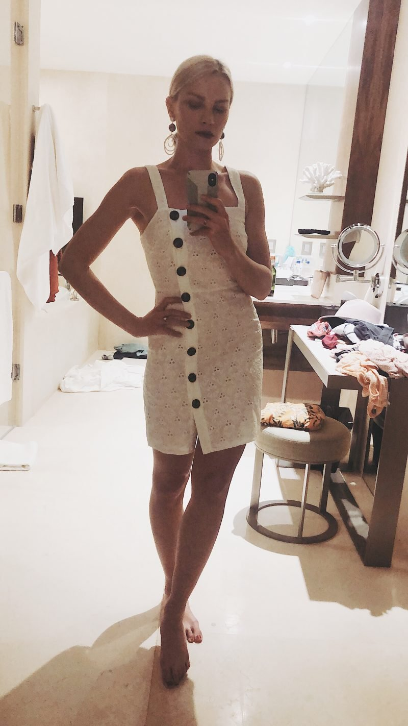 woman in a white dress posing in a mirror
