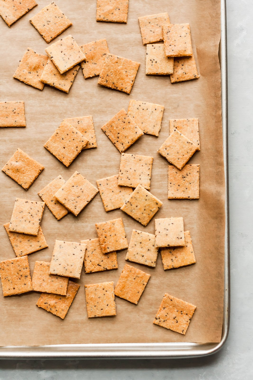 Paleo crackers made with almond flour! You'll only need 4 ingredients for these delicious, protein packed low carb crackers. Plus we've got 5 different flavor variations for you to try.