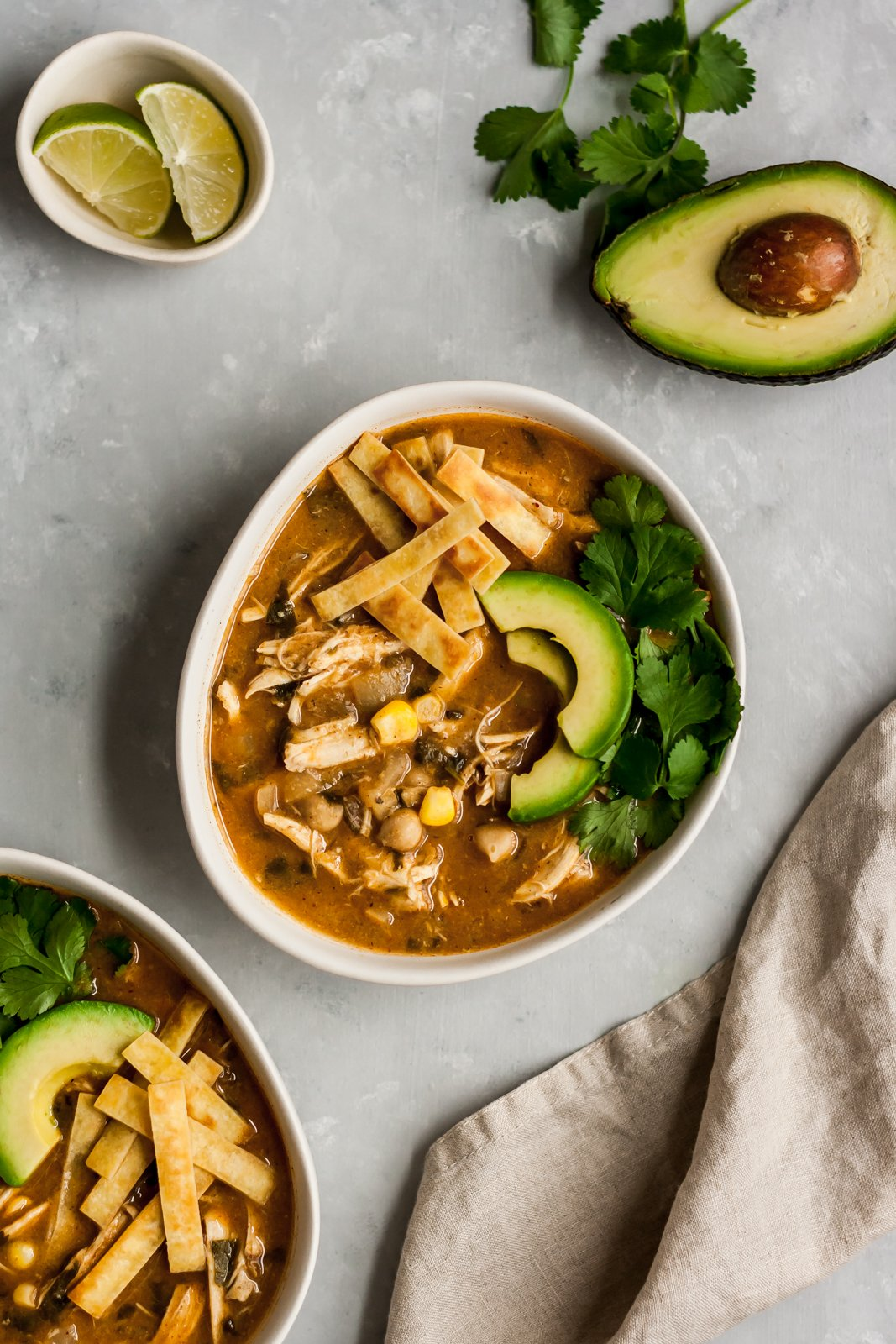 Healthy white chicken chili that's easy and dairy free. Made with green chile, chicken, corn and blended chickpeas to make it creamy. A new family favorite recipe! Serve with avocado, tortilla chips and cilantro.