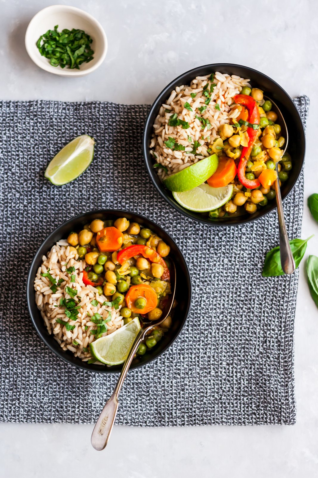 lemongrass chickpea thai green curry in two bowls with rice