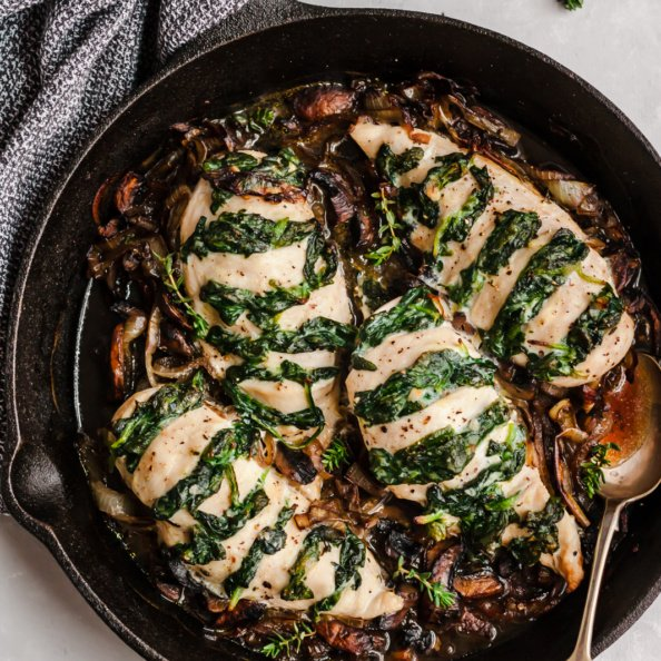 low carb spinach stuffed chicken in a skillet