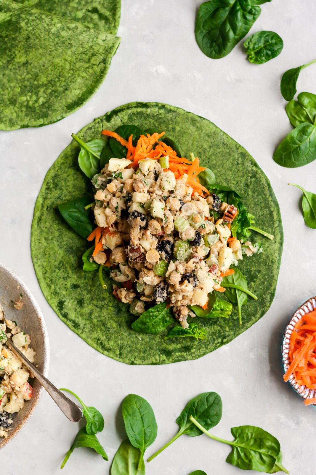Vegan Pecan Apple Chickpea Salad Wraps with a creamy maple dijon tahini dressing. Takes 15 minutes to make and no cooking involved, making this a great recipe for healthy lunches and parties! Enjoy the salad in your favorite wrap, on toast, as-is or even in lettuce cups!