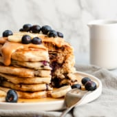 The best recipe for fluffy vegan pancakes on the internet! Options to make them thin or thick and add in whatever your heart desires. These vegan pancakes will be your new family favorite.