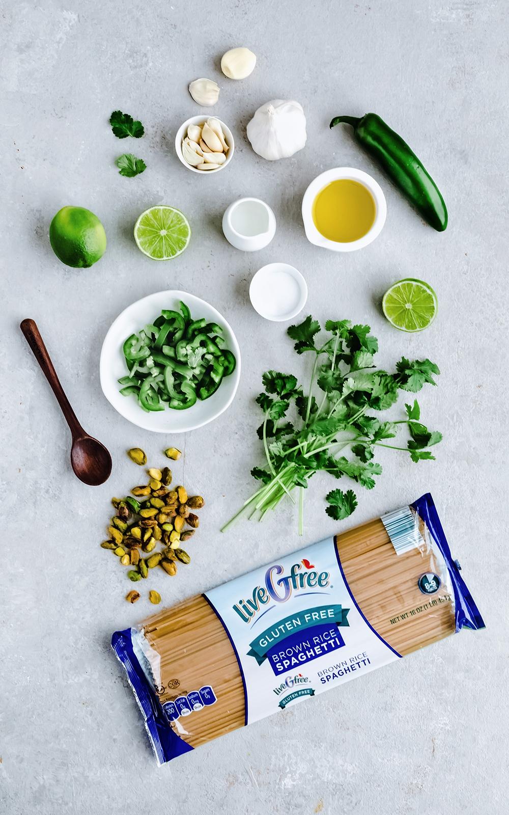 healthy pesto shrimp pasta ingredients on a board