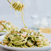 Pesto shrimp pasta with a crazy good fresh cilantro pistachio pesto! This pasta is easy to make but will make you feel like you're at a fancy restaurant. Serve with garlic bread or a side salad for a great 'date night in' meal. This recipe is in partnership with ALDI.
