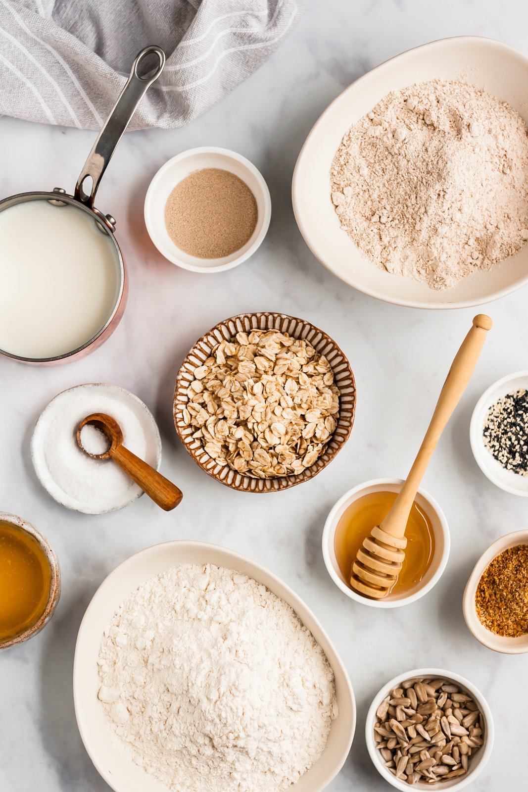 ingredients for homemade healthy sandwich bread on a grey board