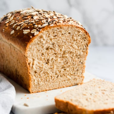 a loaf of homemade healthy sandwich bread with two slices cut out