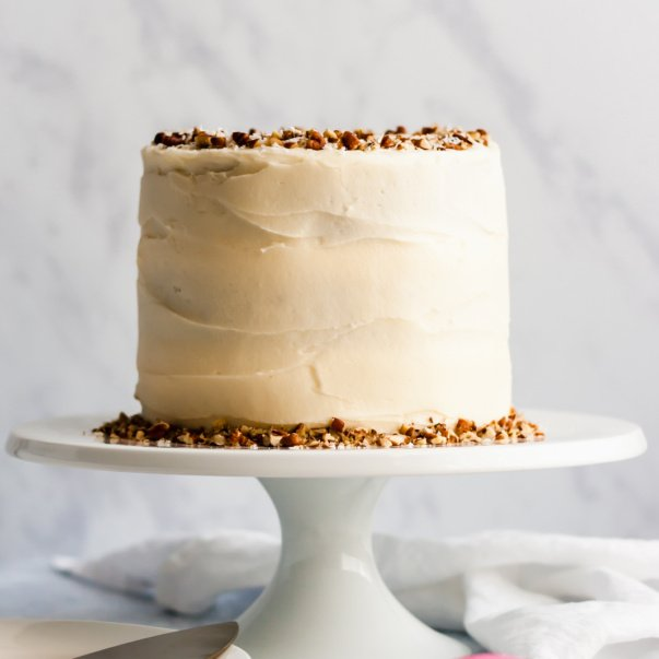 healthy gluten free carrot cake on a cake stand