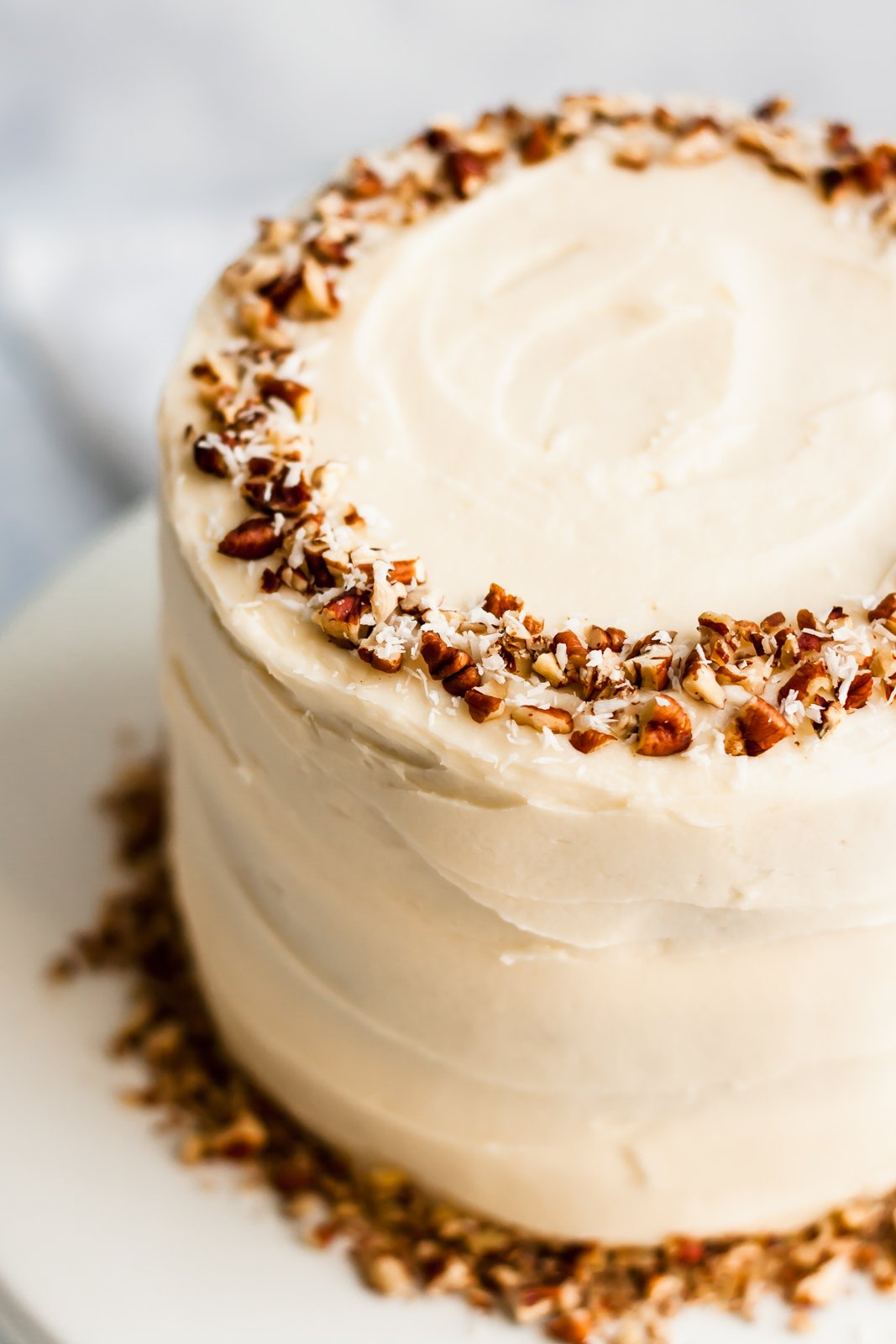 healthy gluten free carrot cake topped with pecans