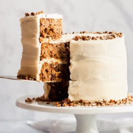 gluten free carrot cake on a cake stand