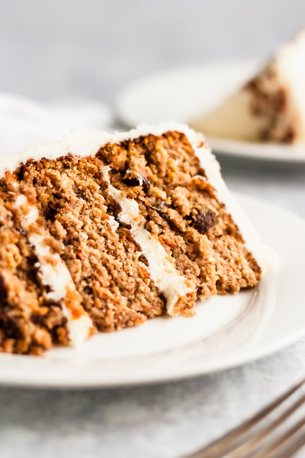 slice of healthy gluten free carrot cake on a plate