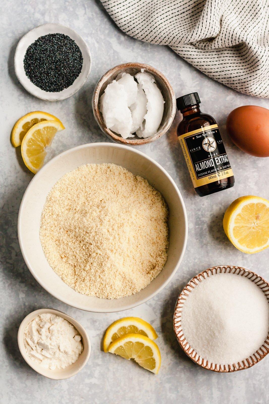 ingredients for paleo lemon poppyseed cookies on a grey board