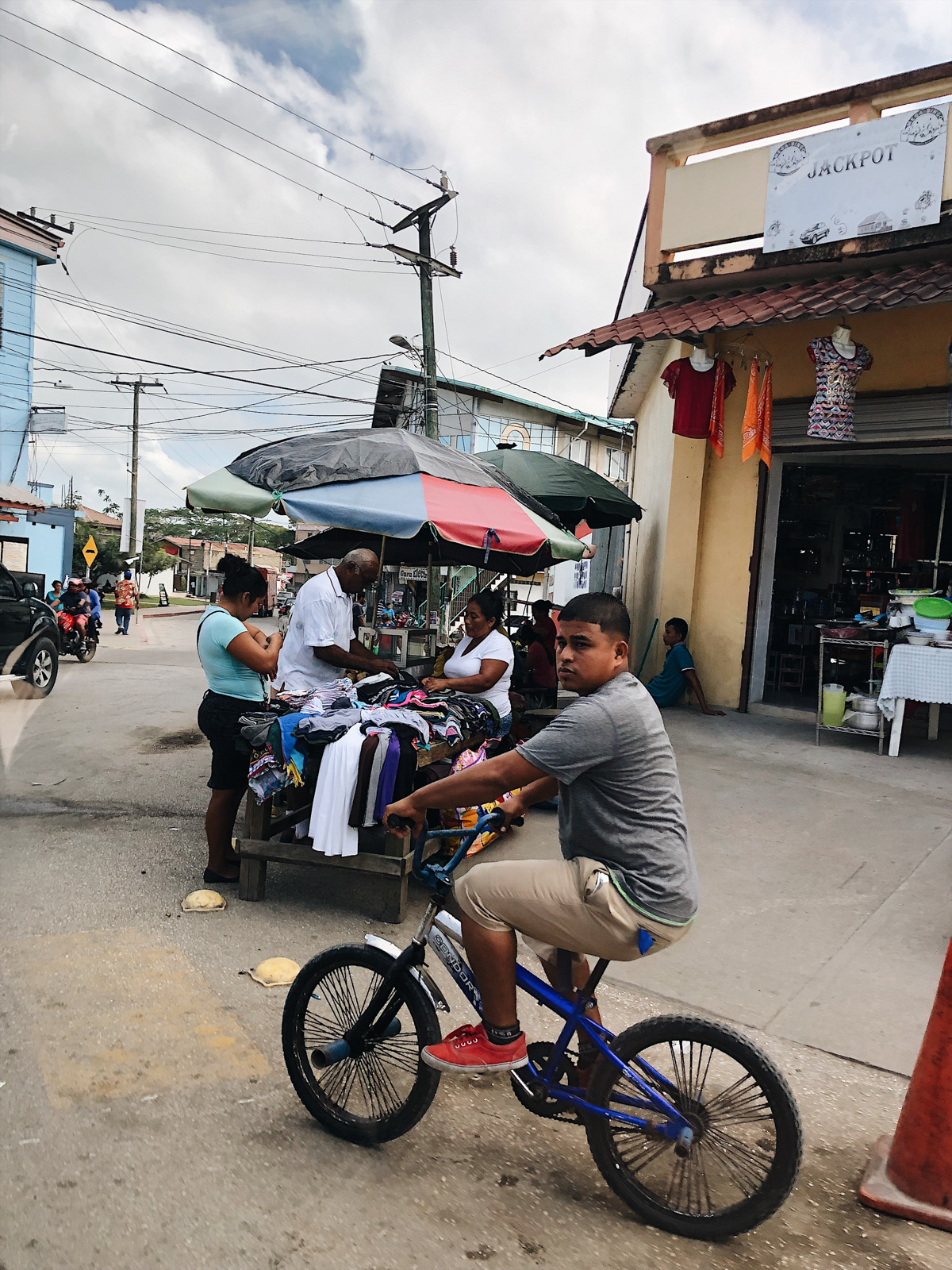 young man on a bike in a small town of Belize