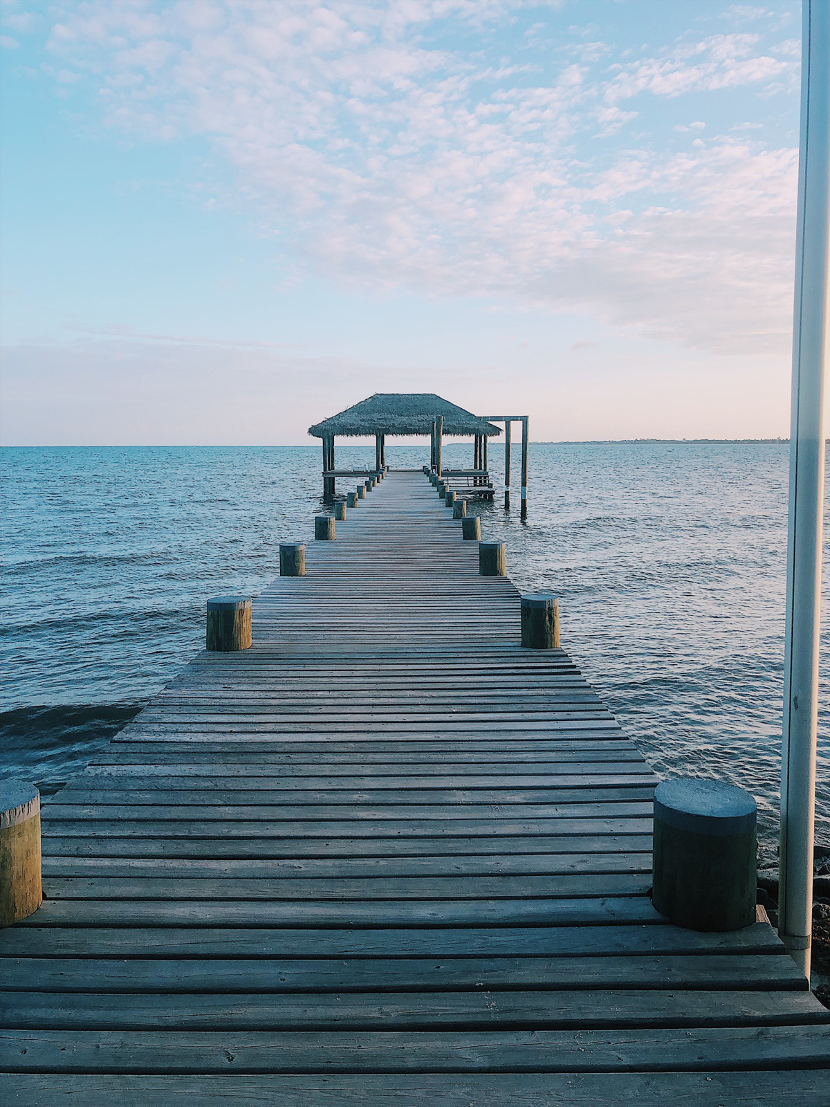view of a dock going out to the ocean