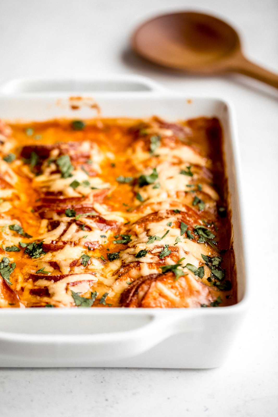 gouda scalloped sweet potatoes in a white baking dish