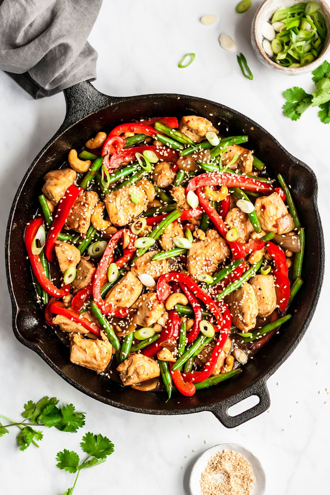 orange chicken stir fry in a skillet pan