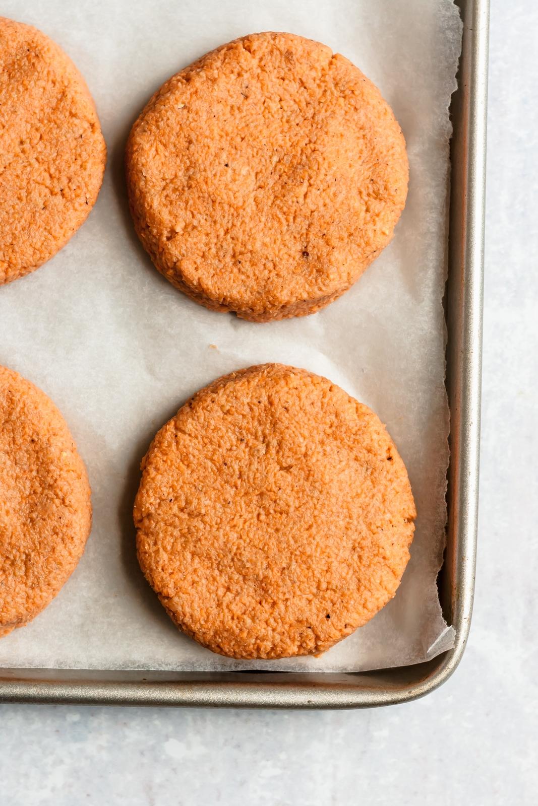 sweet potato salmon cakes on a baking sheet