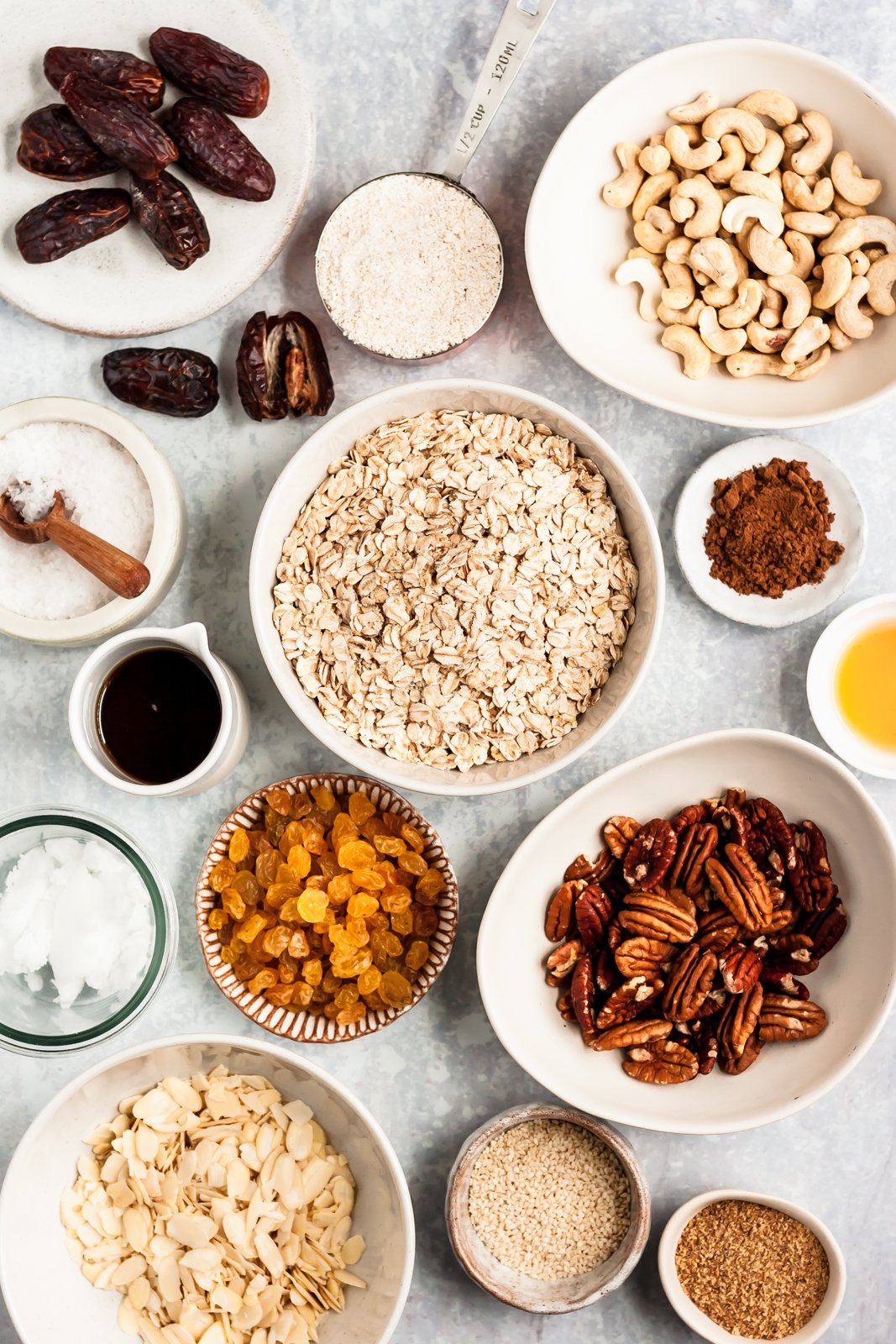 healthy granola recipe ingredients on a gray surface
