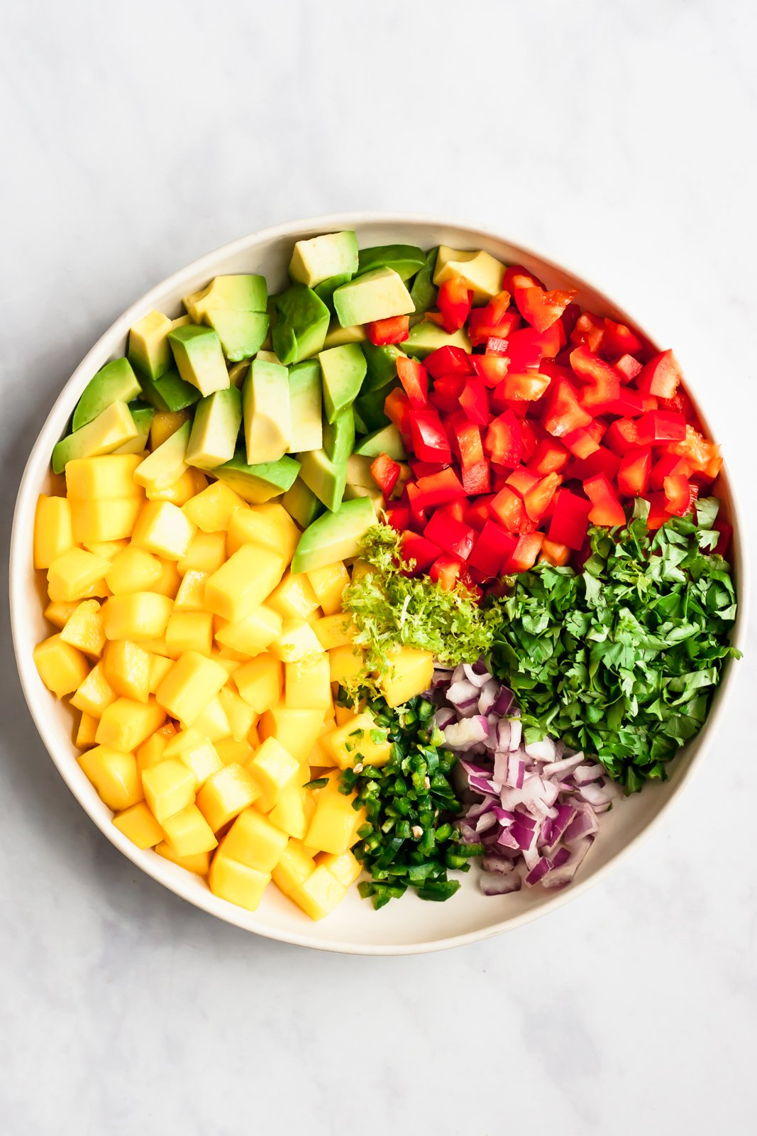 fresh mango salsa ingredients in a bowl