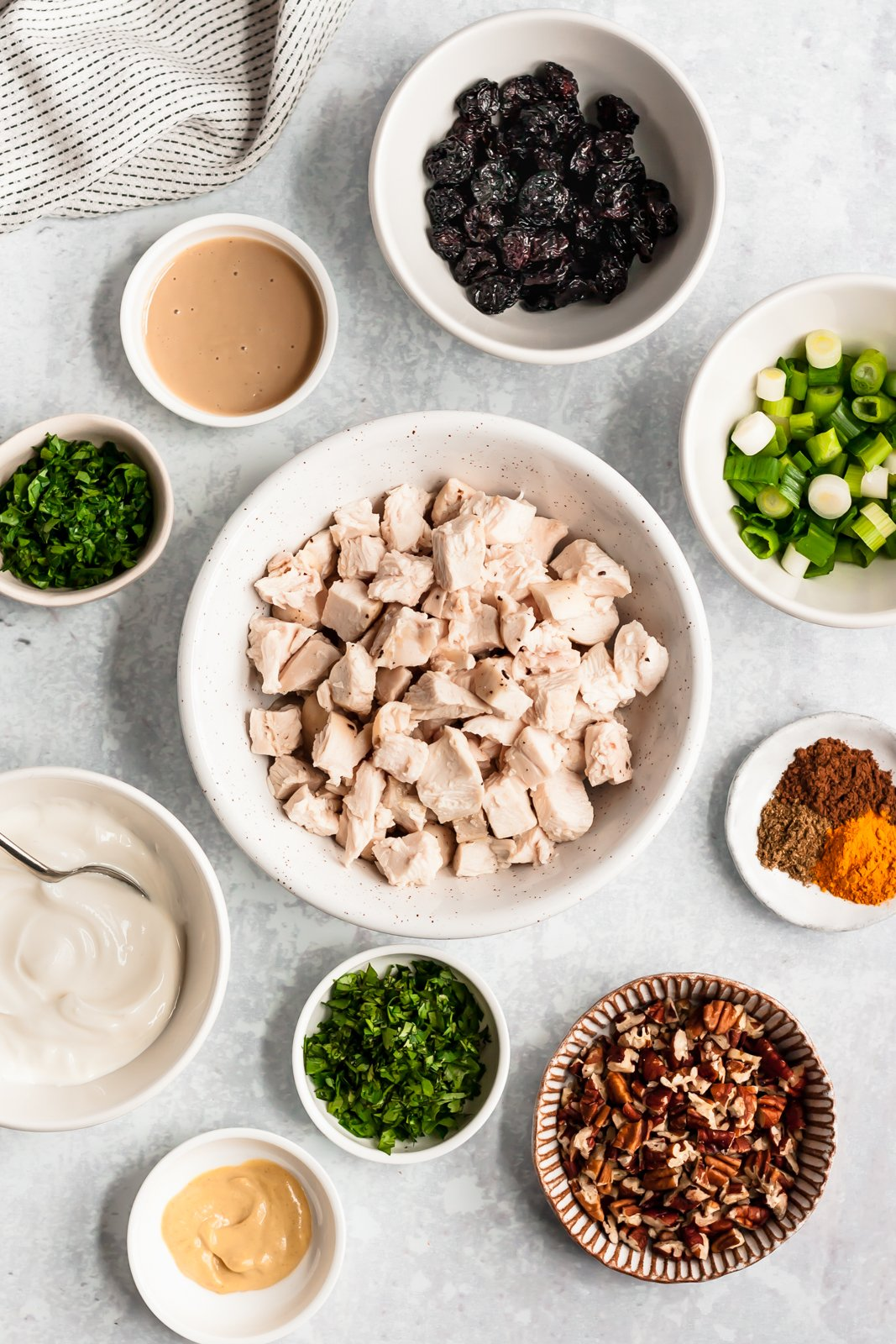 healthy chicken salad ingredients on a gray board