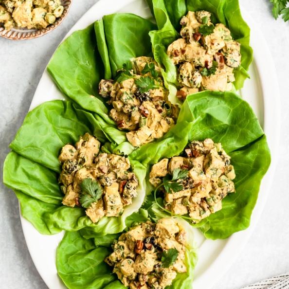 healthy greek yogurt chicken salad in lettuce cups on a platter