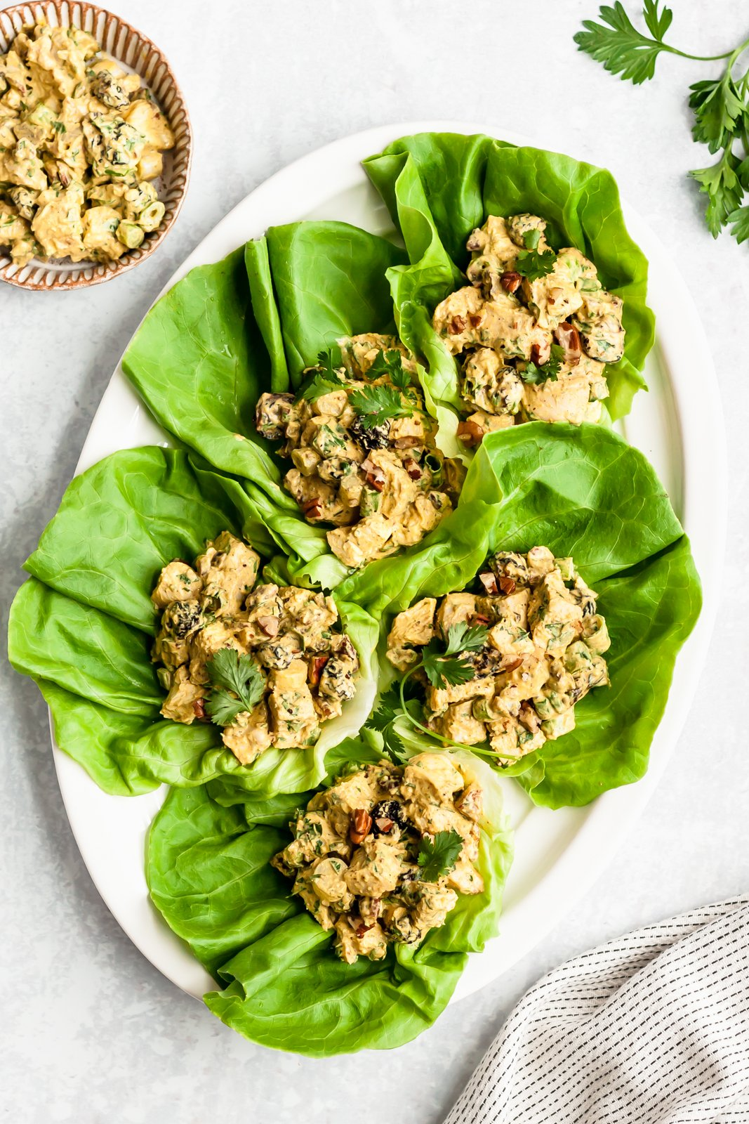 healthy chicken salad in lettuce cups on a platter