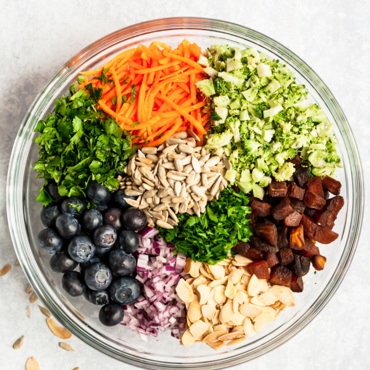 healthy broccoli salad ingredients in a bowl