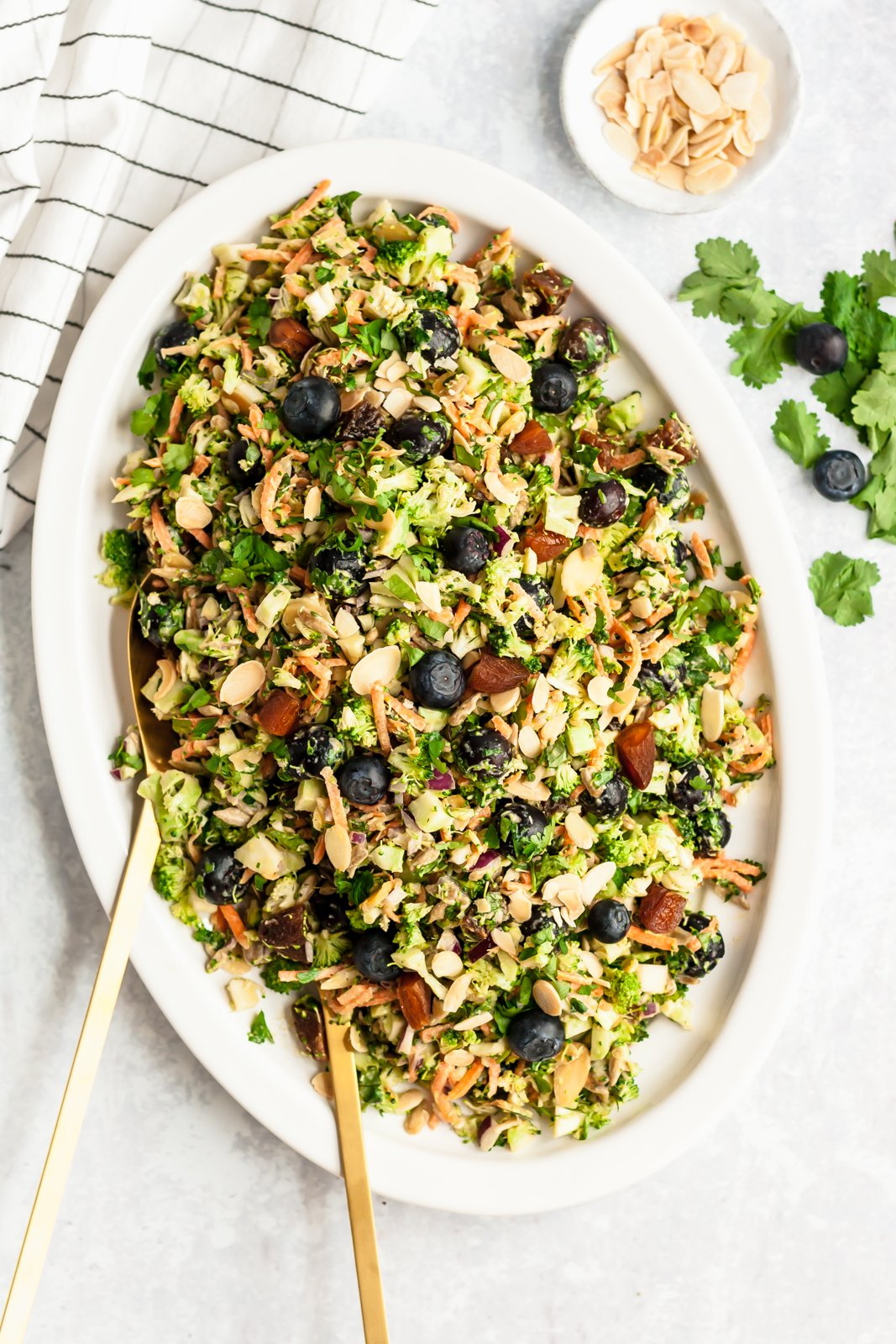 healthy broccoli salad with blueberries and toasted almonds on a platter