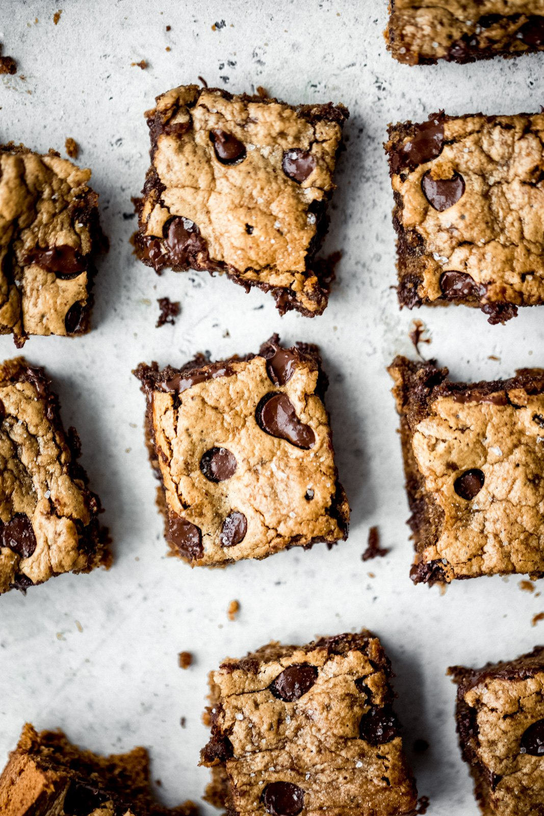 almond butter blondies cut into bars and laying on a board