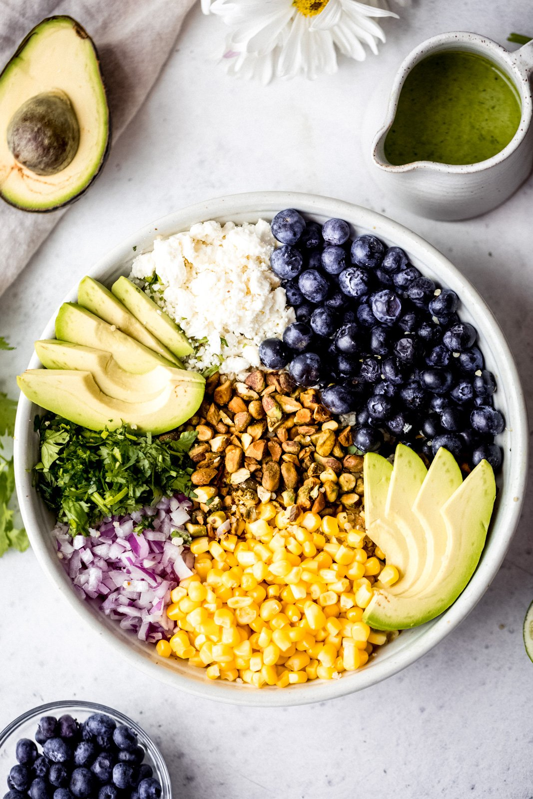blueberry quinoa salad ingredients in a bowl