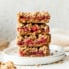 four tart cherry pie bars in a stack on a plate