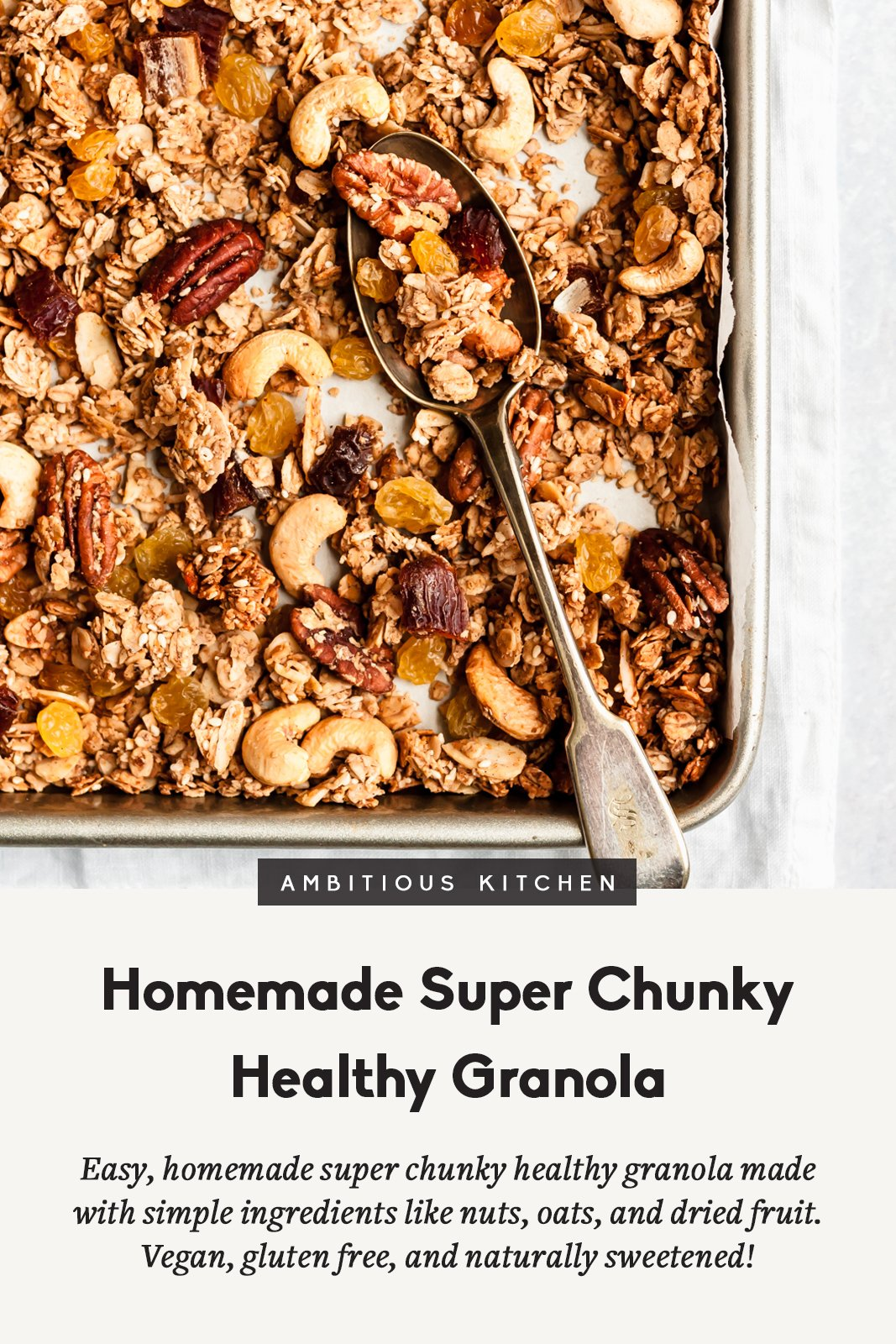 homemade healthy granola on a baking tray with a spoon and text underneath