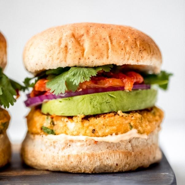 vegan sweet potato burger on a wooden board