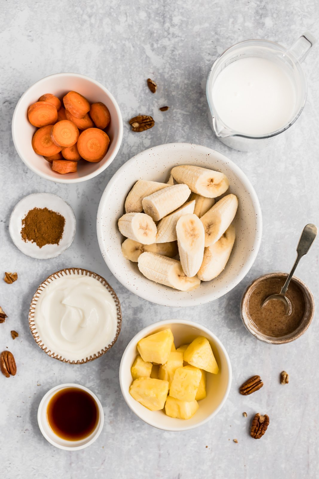 carrot cake smoothie ingredients in bowls