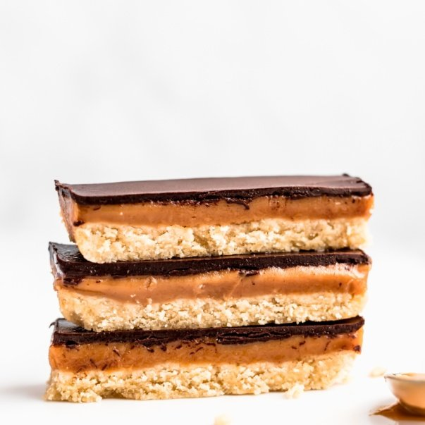 three healthy homemade twix bars stacked on top of eachother