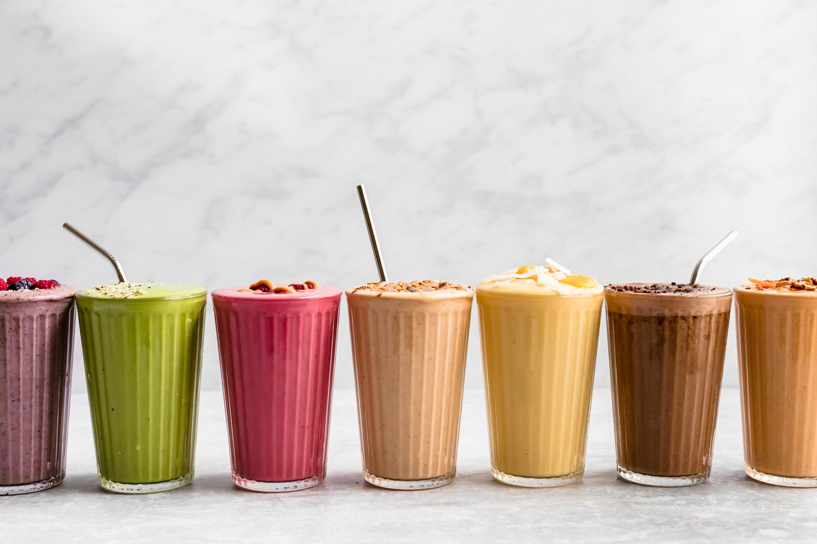 different colored smoothies all lined up