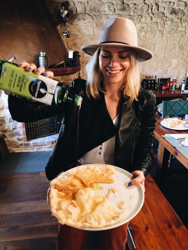 monique pouring olive oil on bread