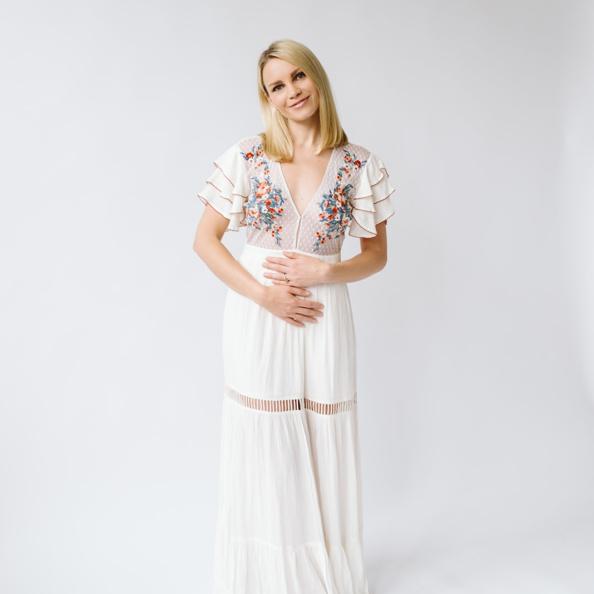 monique in a white dress