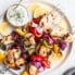 greek chicken kabobs on a plate with tzatziki sauce