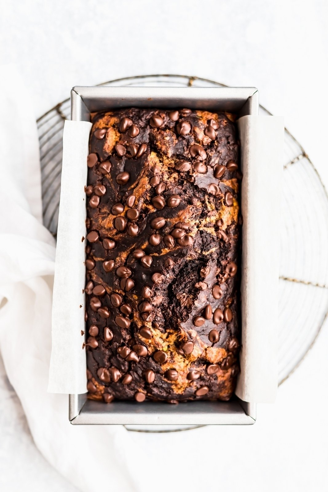 marbled chocolate zucchini banana bread in a loaf pan