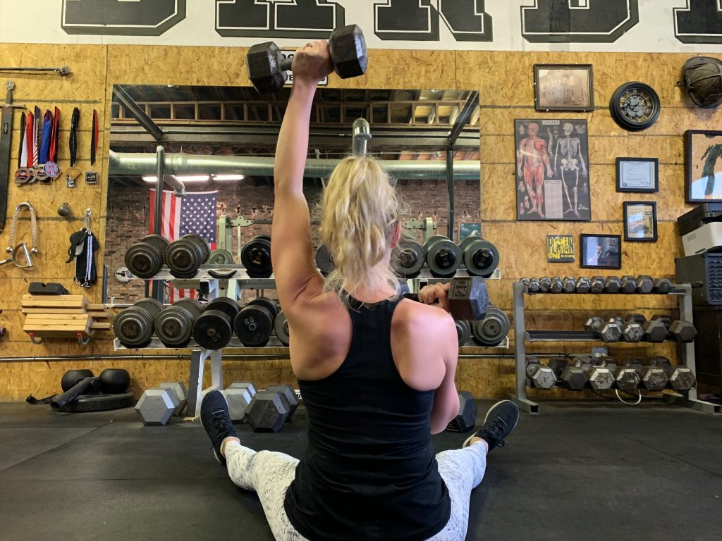 monique lifting weights in a gym