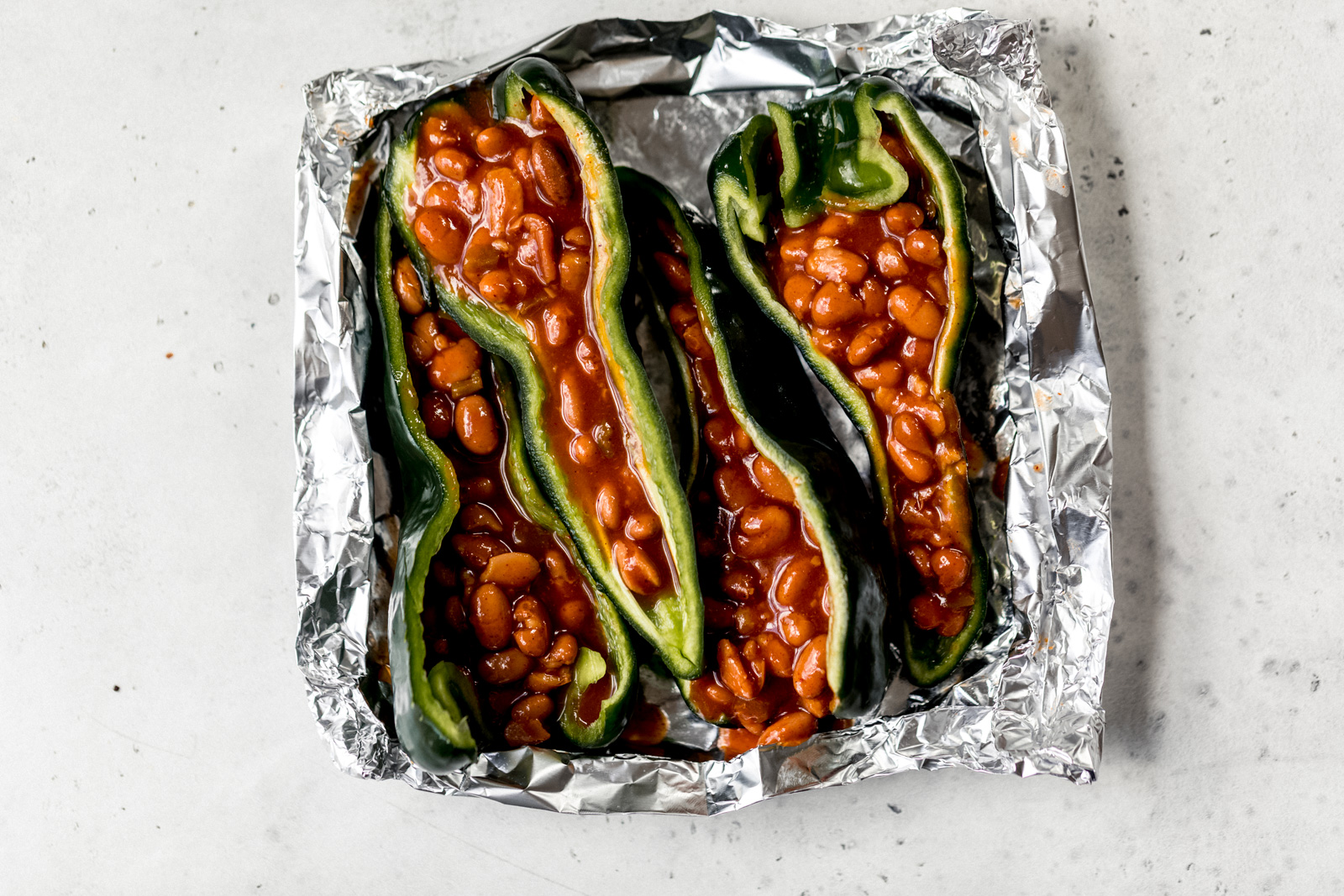 stuffed poblanos peppers in a foil packet