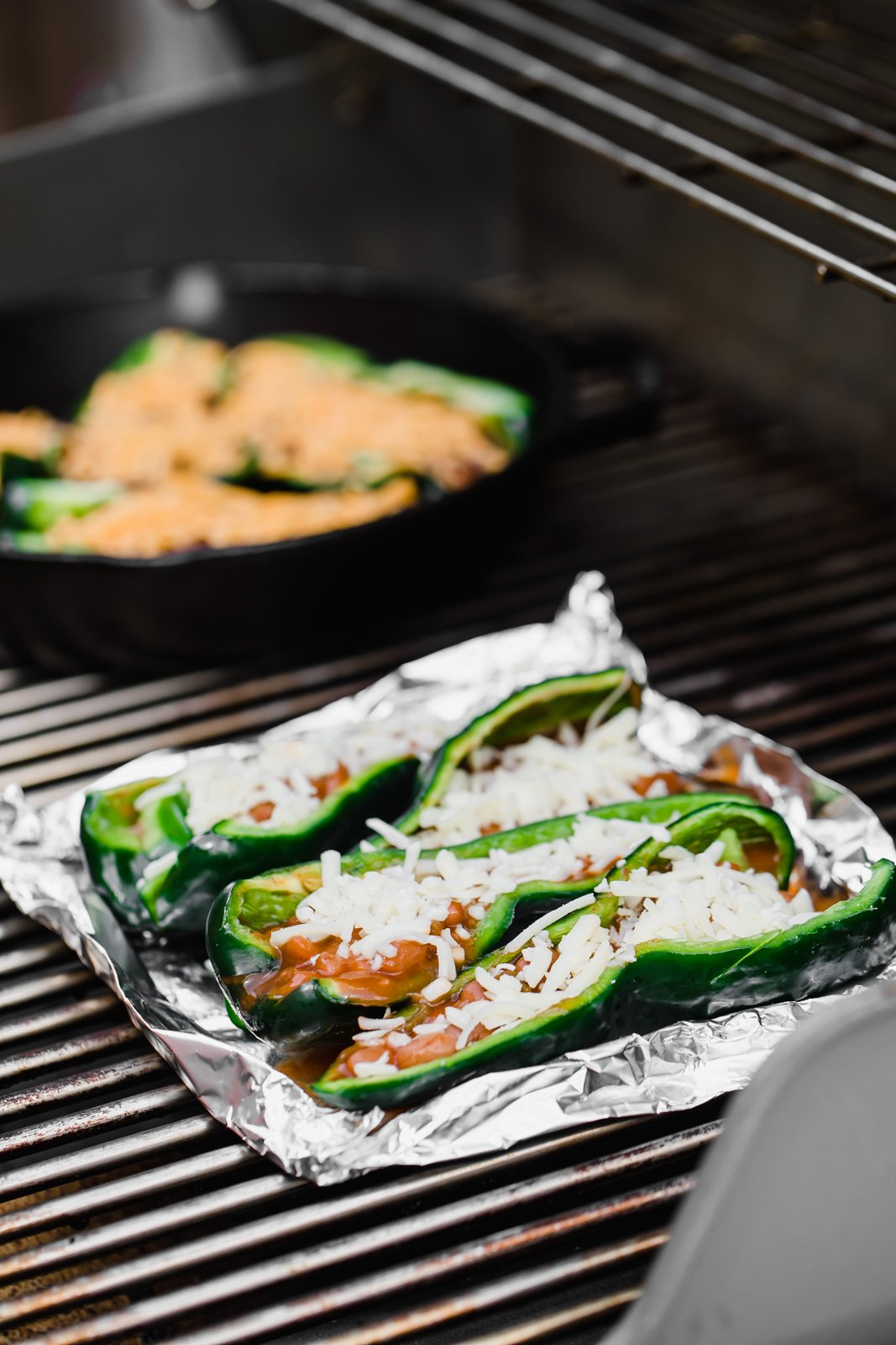 stuffed poblano peppers on a grill