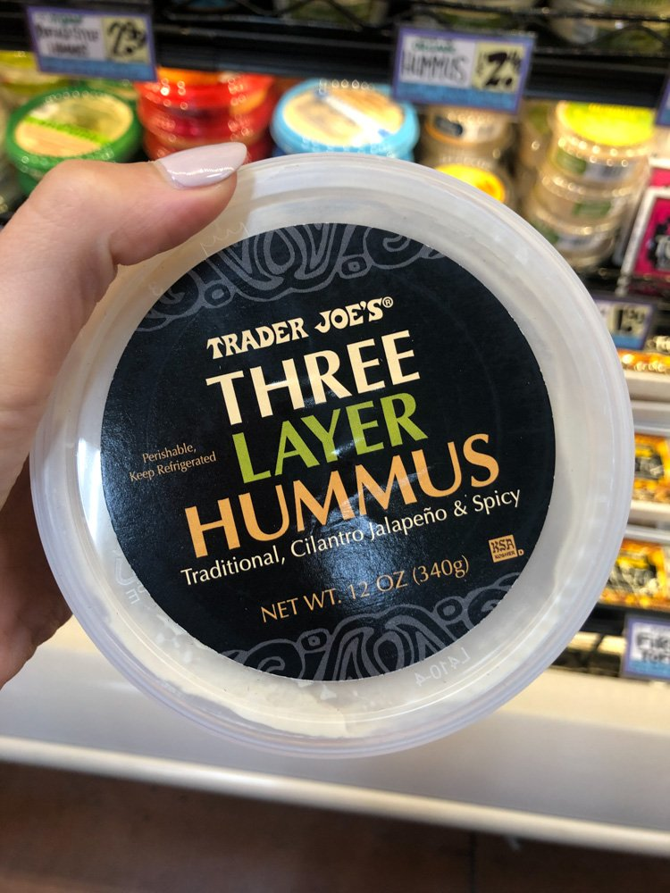 container of three layer hummus