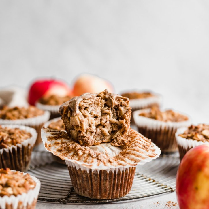 two apple cinnamon baked oatmeal cups in a stack with a bite taken out