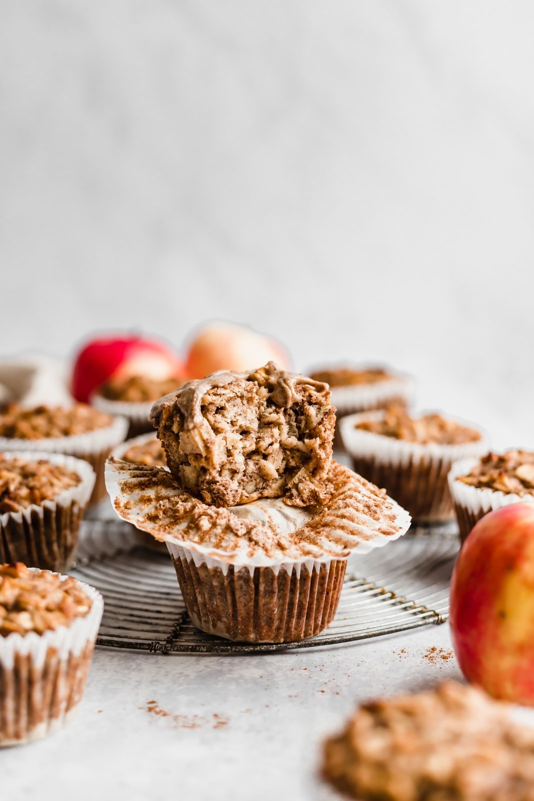 apple cinnamon oatmeal cups stacked on top of eachother with a bite taken out