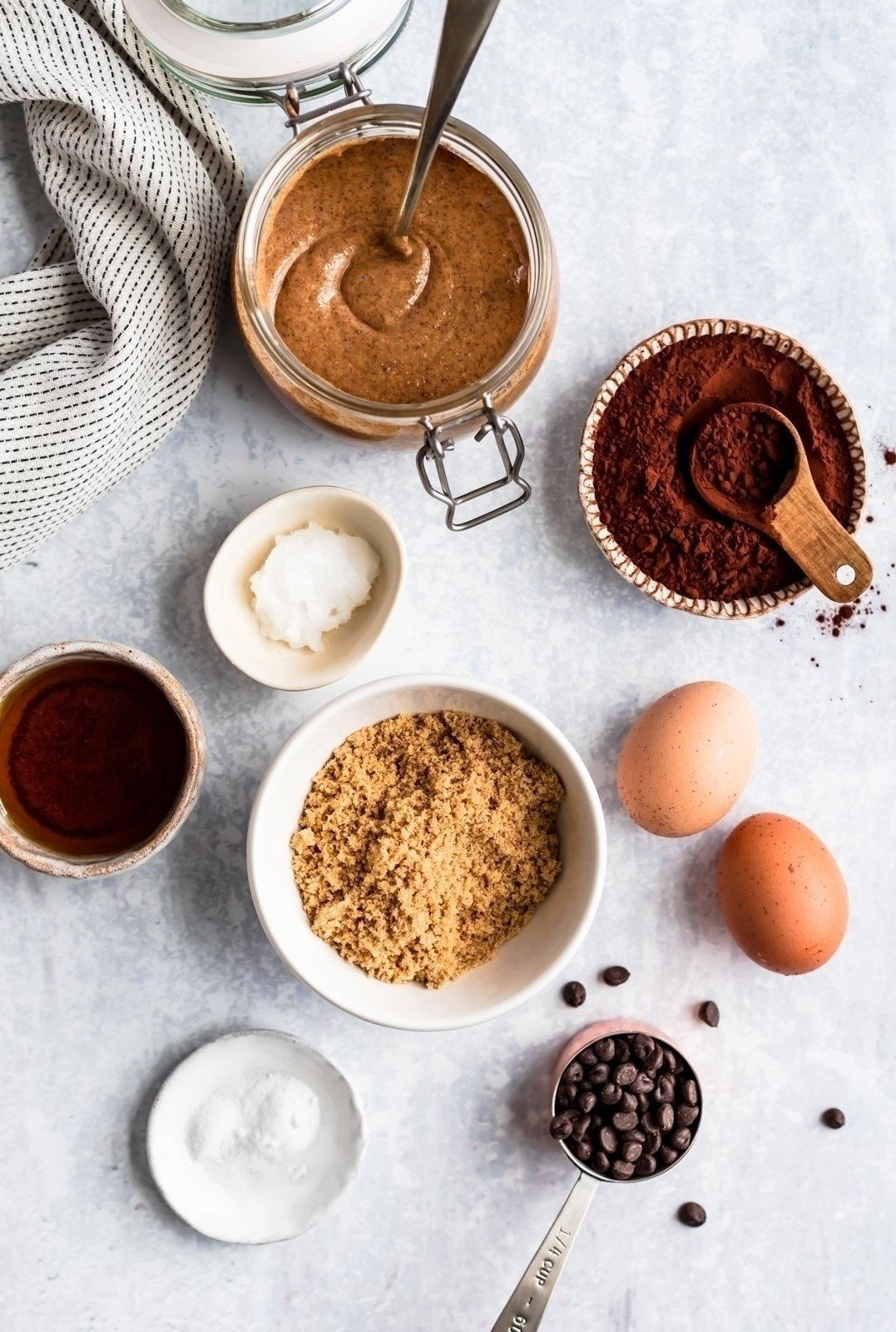 ingredients for almond butter brownies on a surface