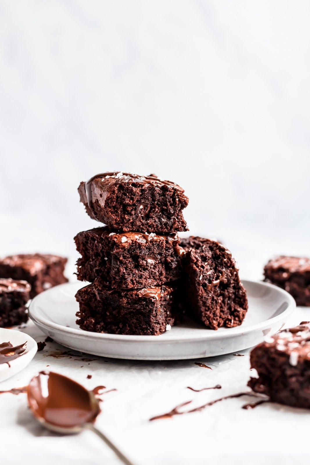 stack of almond butter brownies on a plate