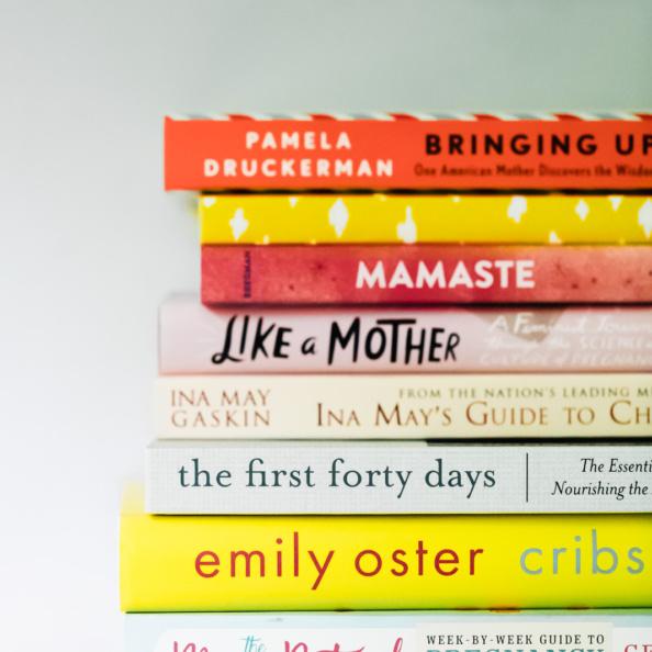 pregnancy books in a stack